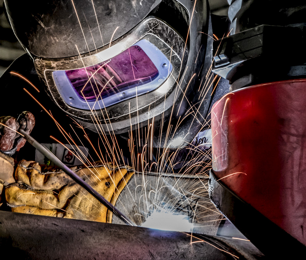 Welder at work at a refinery machine shop in Cherry Point, Washinton.