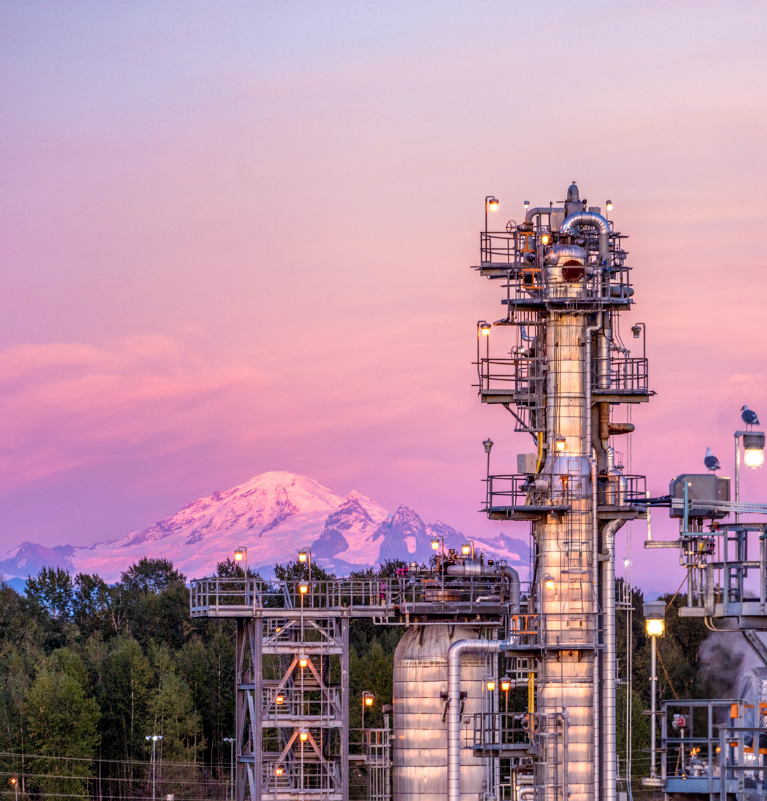 Cherry Point Refinery in Washington State during sunset with Mt. Baker in the distance.